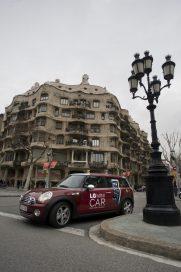 The LG Mini car driving around the beautiful, unique architecture of Barcelona