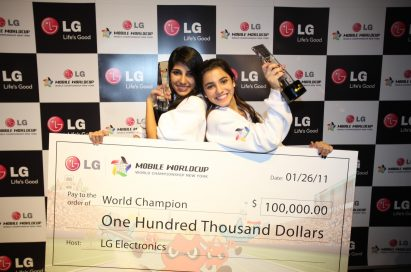 Winners of the LG Mobile Worldcup Championship 2010-2011, Cristina Sales Ancines and Jennifer Sales Ancines from Panama, pose with their award and winnings