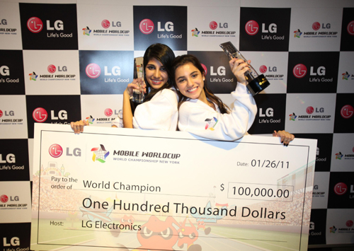 Winners of the LG Mobile Worldcup Championship 2010-2011, Cristina Sales Ancines and Jennifer Sales Ancines from Panama, pose with their award and winnings.