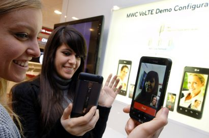 Two female models are demonstrating Video Call via LTE in LG's booth