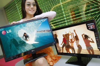 A model wearing 3D glasses presents two LG Cinema 3D Monitors