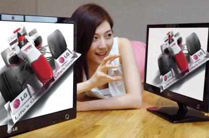 A model poses with LG's glasses-free 3D monitors (model D2000)