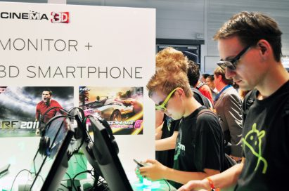 Visitors experiencing LG 3D smartphones at LG 3D Game Festival in Gamescom