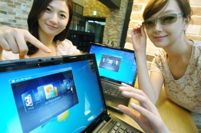 Two models present LG 3D notebooks while one of them wears 3D glasses
