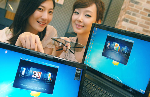 Two models present LG 3D notebooks while one of them holds 3D glasses.
