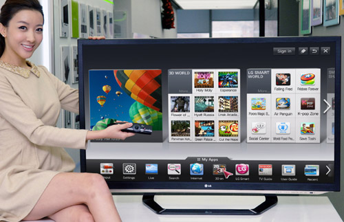 A model is demonstrating the newest Smart TV features with a 2012 LG CINEMA 3D Smart TV.