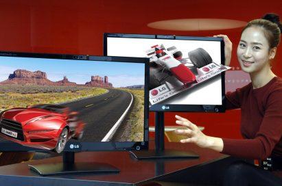 A model presents two of LG's 25-inch Glasses-Free 3D monitors
