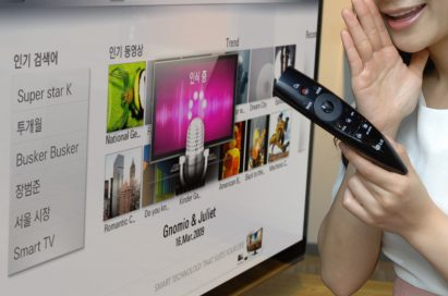 A close-up of a model demonstrating LG's new Magic Remote with the LG CINEMA 3D Smart TV