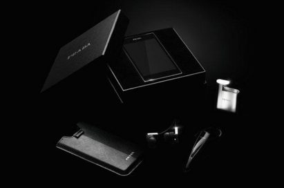 All components of the PRADA phone by LG 3.0 including PRADA branded box, back cover case, cradle and Bluetooth ear set are displayed