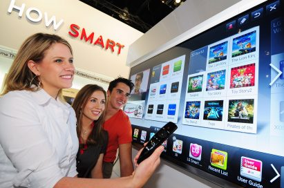 Visitors to the LG booth trying LG's Proprietary Smart TV Platform, NetCast, at CES 2012
