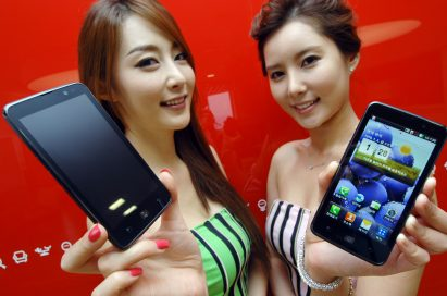 Two female models hold LG Optimus LTE and show its front views