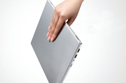 A person effortlessly carries the LG Ultrabook model Z330 with just one hand