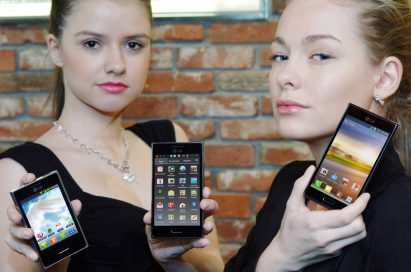 Two female models hold LG Optimus L3, LG Optimus L5 and LG Optimus L7 and show its front views