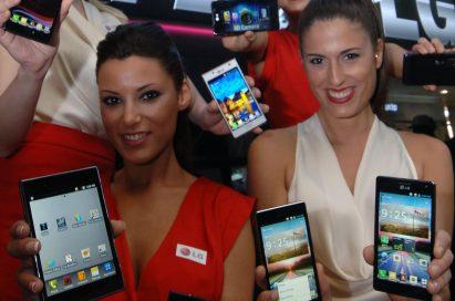 4 female models hold LG Optimus Vu:, LG Optimus 4X HD, LG Optimus 3D Max and LG Optimus L7 and show its front and rear views at LG Booth
