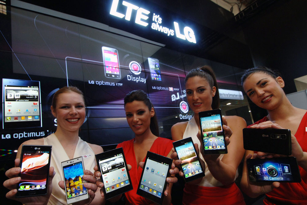 Last image of four female models holding eight LG LTE smartphones at MWC 2012