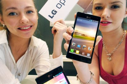 Two models hold up a LG Optimus 4X HD each while one also holds up the LG Optimus 4X HD logo in her other hand