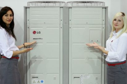 Two models posing next to LG's Multi V III