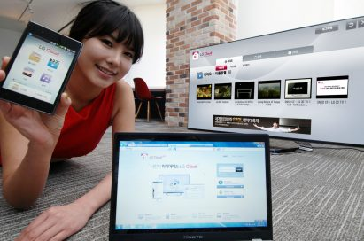 A model introduces the LG Cloud service which is compatible with TVs, mobile devices and PCs while lying down on the floor