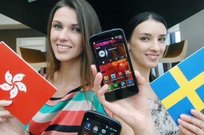 A third view of a model holding a Hong Kong flag and the LG Optimus HD LTE while another holds up the flag of Sweden and another LG Optimus HD LTE, all while in front of the Germany, Portugal and Singapore flags