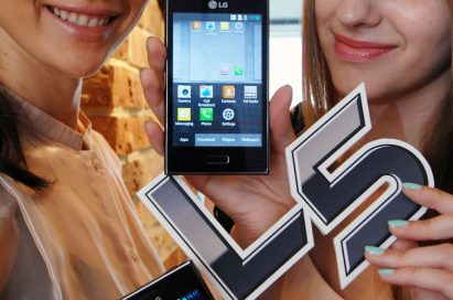Close view of two women holding two LG OPTIMIUS L5s between them