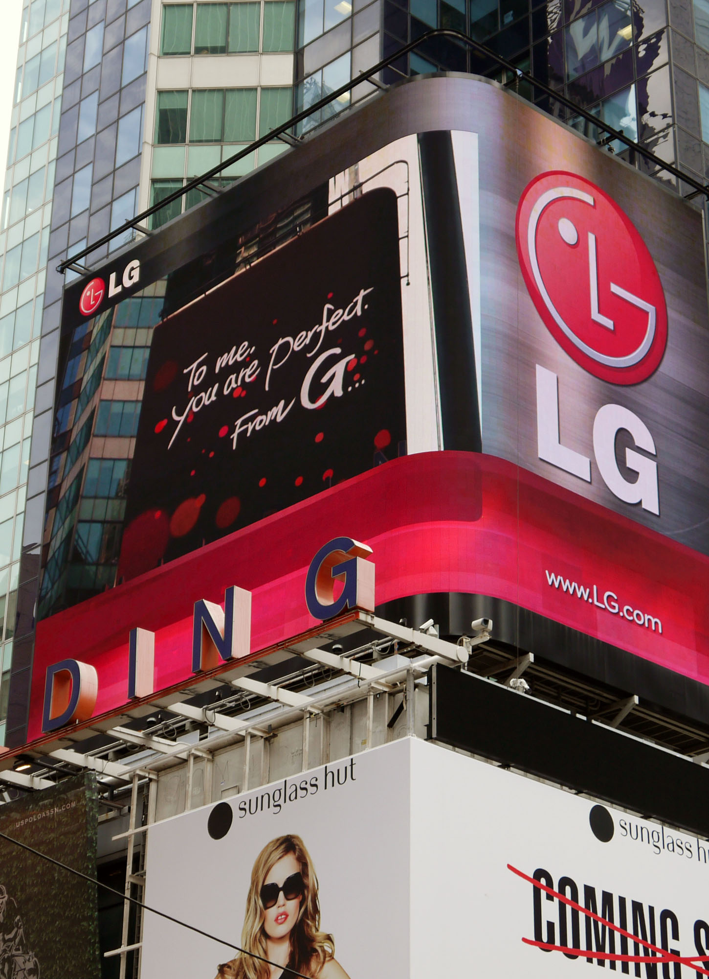 "A Times Square billboard saying ""To me, you are perfect. From G"""