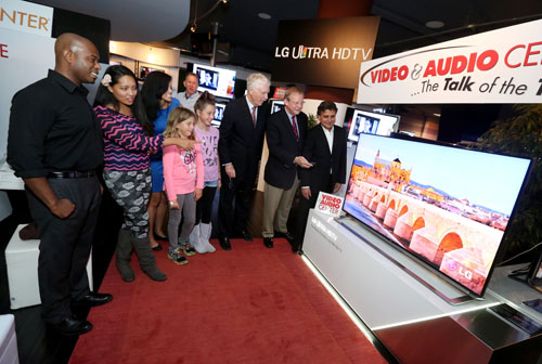 Visitors look at the LG Ultra HD TV model LA9700 on display at the Video&Audio Center.