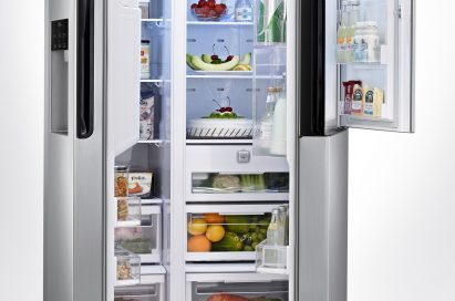 The LG French-Door refrigerator with its large doors opened to show off its Door-in-Door feature located on the top of the right door