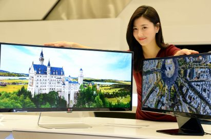 A model presenting the 34-inch and 29-inch IPS 21:9 UltraWide monitors while putting her hands on both