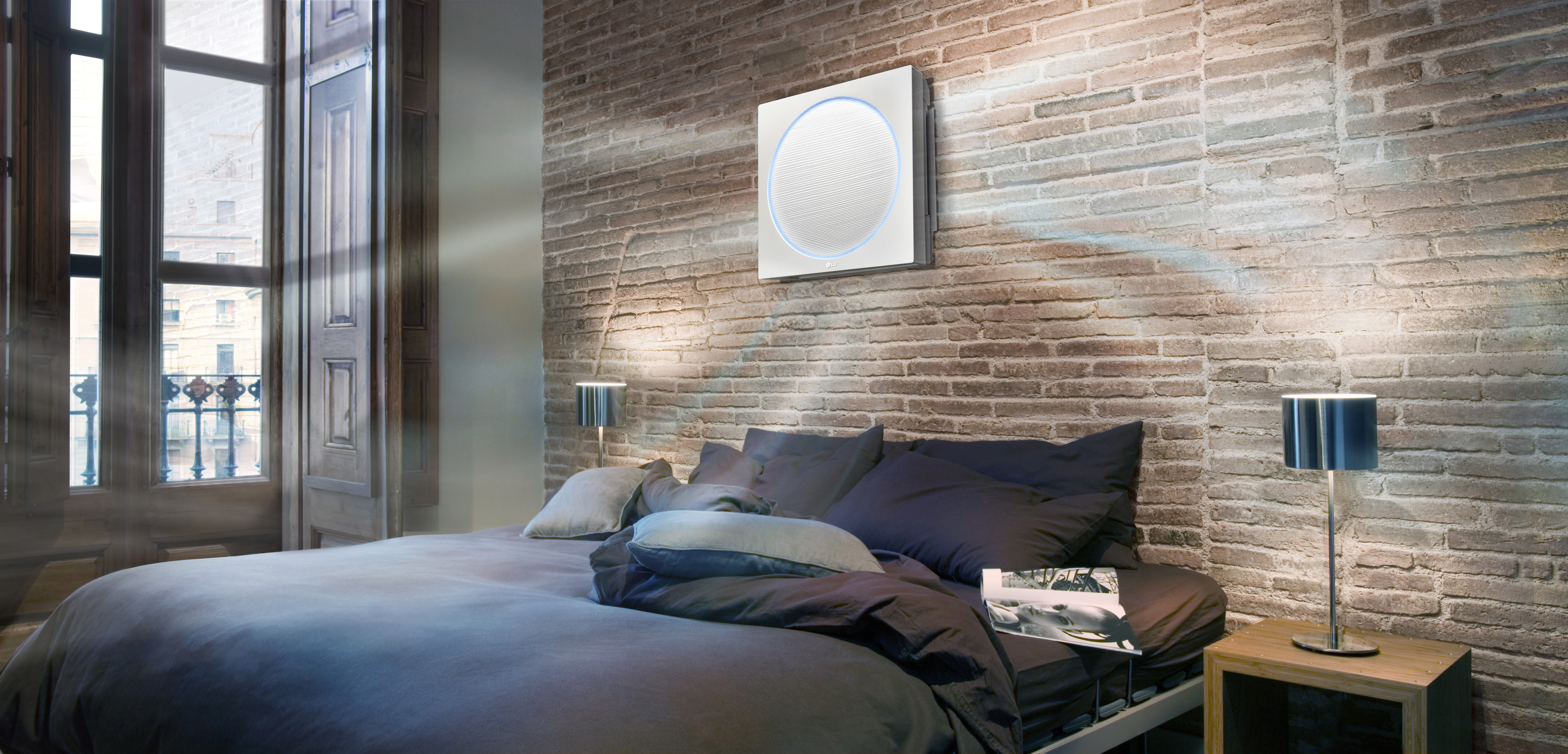 LG ARTCOOL Stylist air conditioner operating in the wall of bedroom