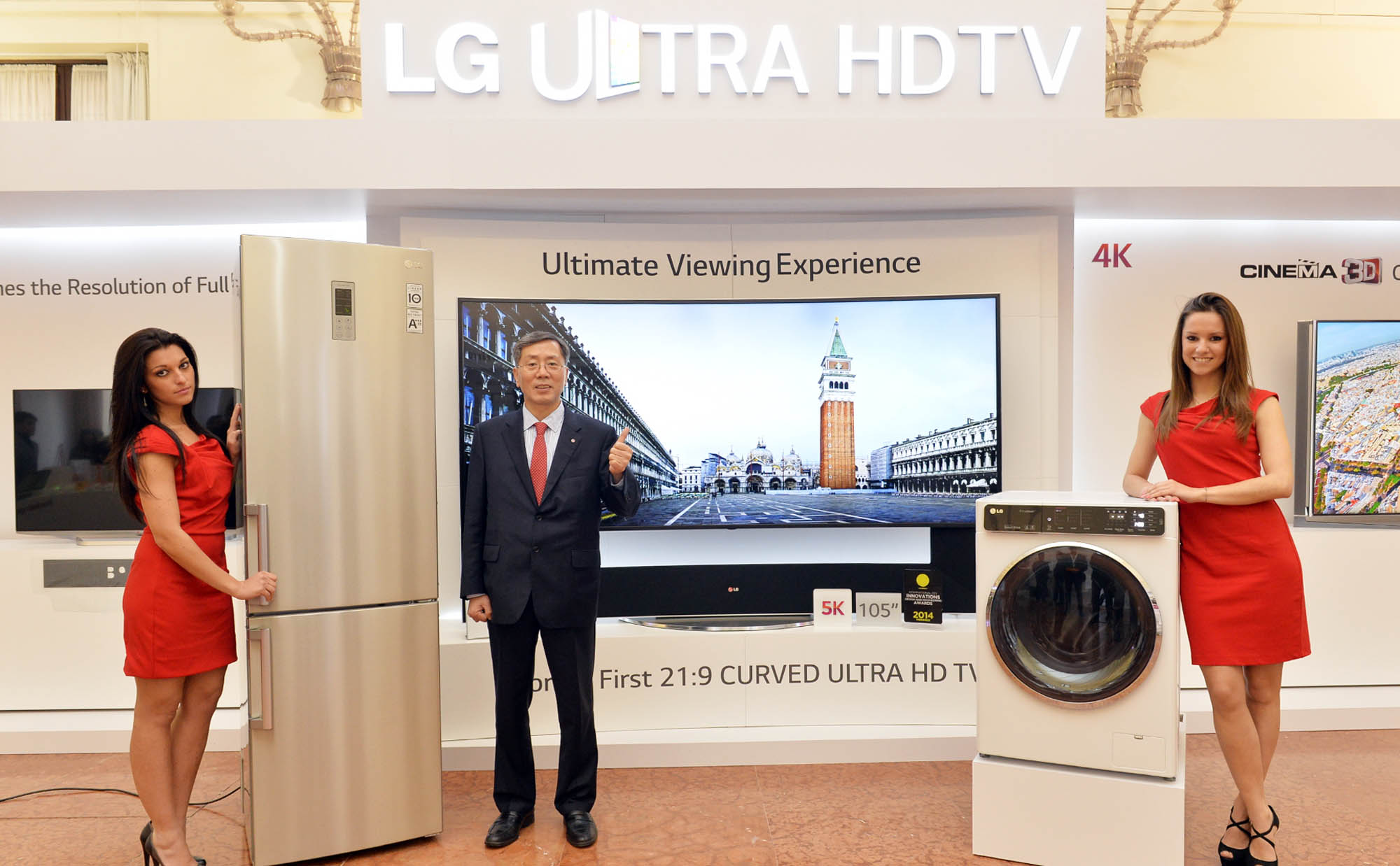 Two models demonstrating LG's washing machine and refrigerator with vice president and Europe region head at LG Electronics, Brian Na, at LG Innovative Festival Europe
