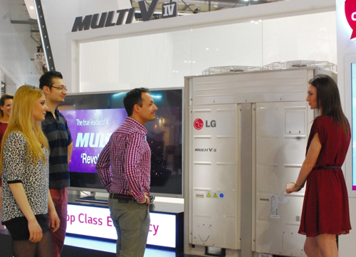 A woman explaining LG Multi V IV to the visitors to LG booth at Mostra Convegno Expocomfort 2014
