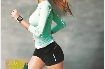 A woman runs while wearing the LG G Watch in White Gold, with a small screenshot of watch's display tracking her steps.