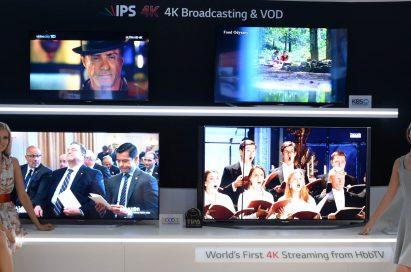 Models present LG's Hybrid Broadcast Broadband TV (HbbTV).