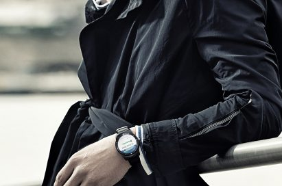 A man wearing the LG G Watch R. as he leans over a rail.