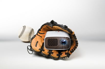 Front view of LG HD MiniBeam model PH300 held inside a baseball glove