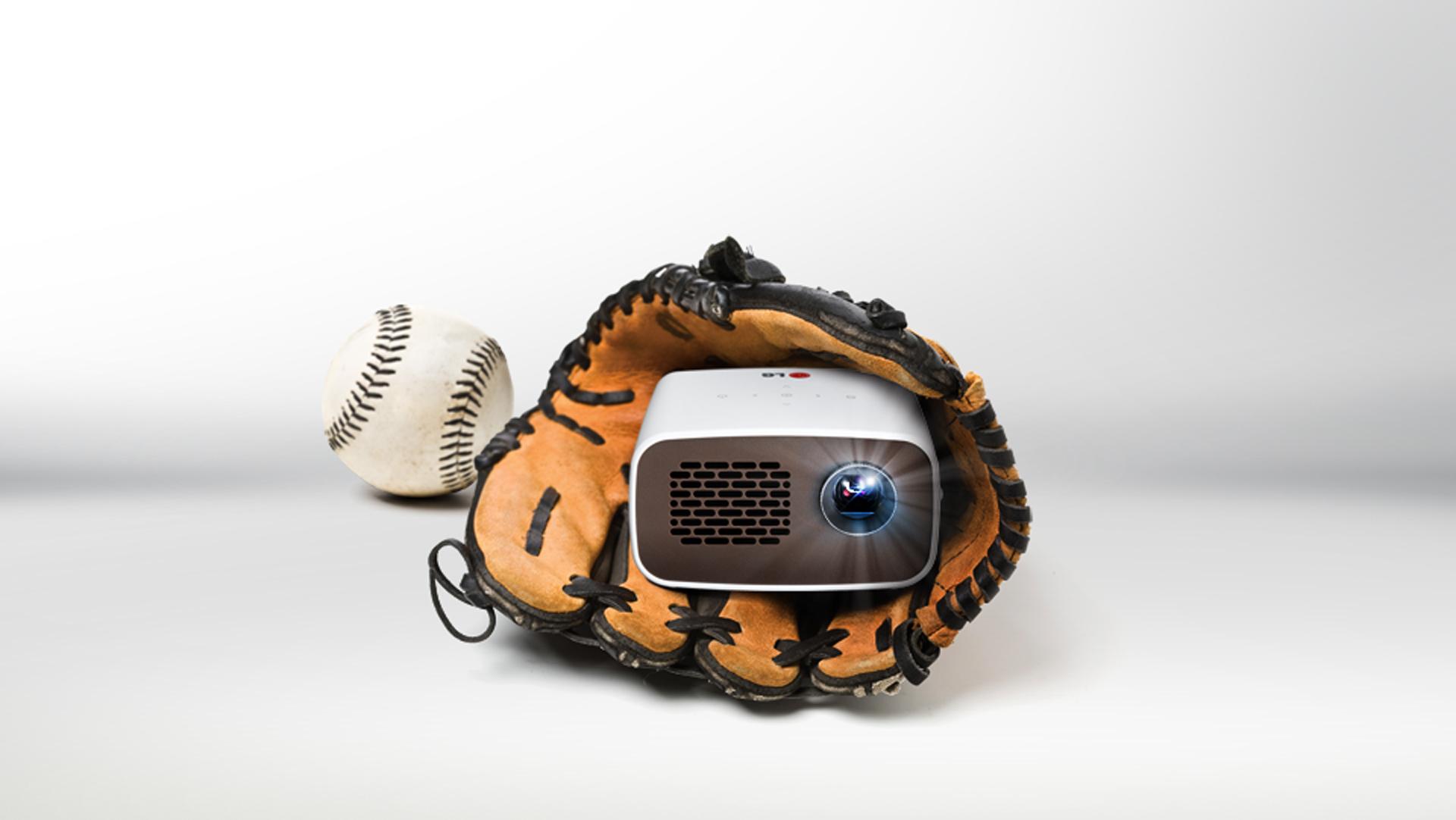 Front view of LG HD MiniBeam model PH300 held inside a baseball glove