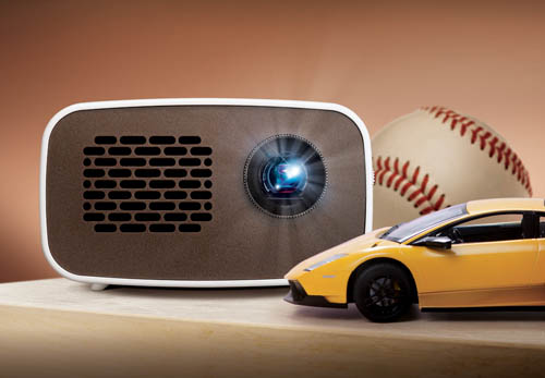 Front view of LG HD MiniBeam model PH300 beaming light on a table next to images of a baseball and supercar.