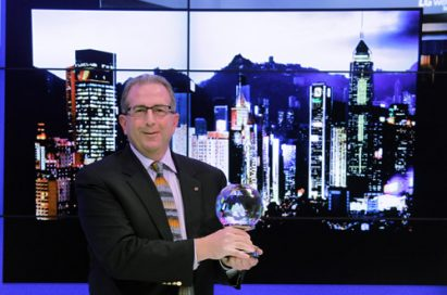 LG representative holds one of the awards earned at CES 2015.