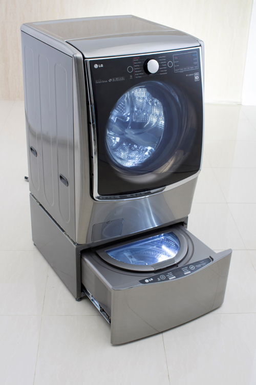Left view of LG TWINWash™ washing machine with its Mini washer opened