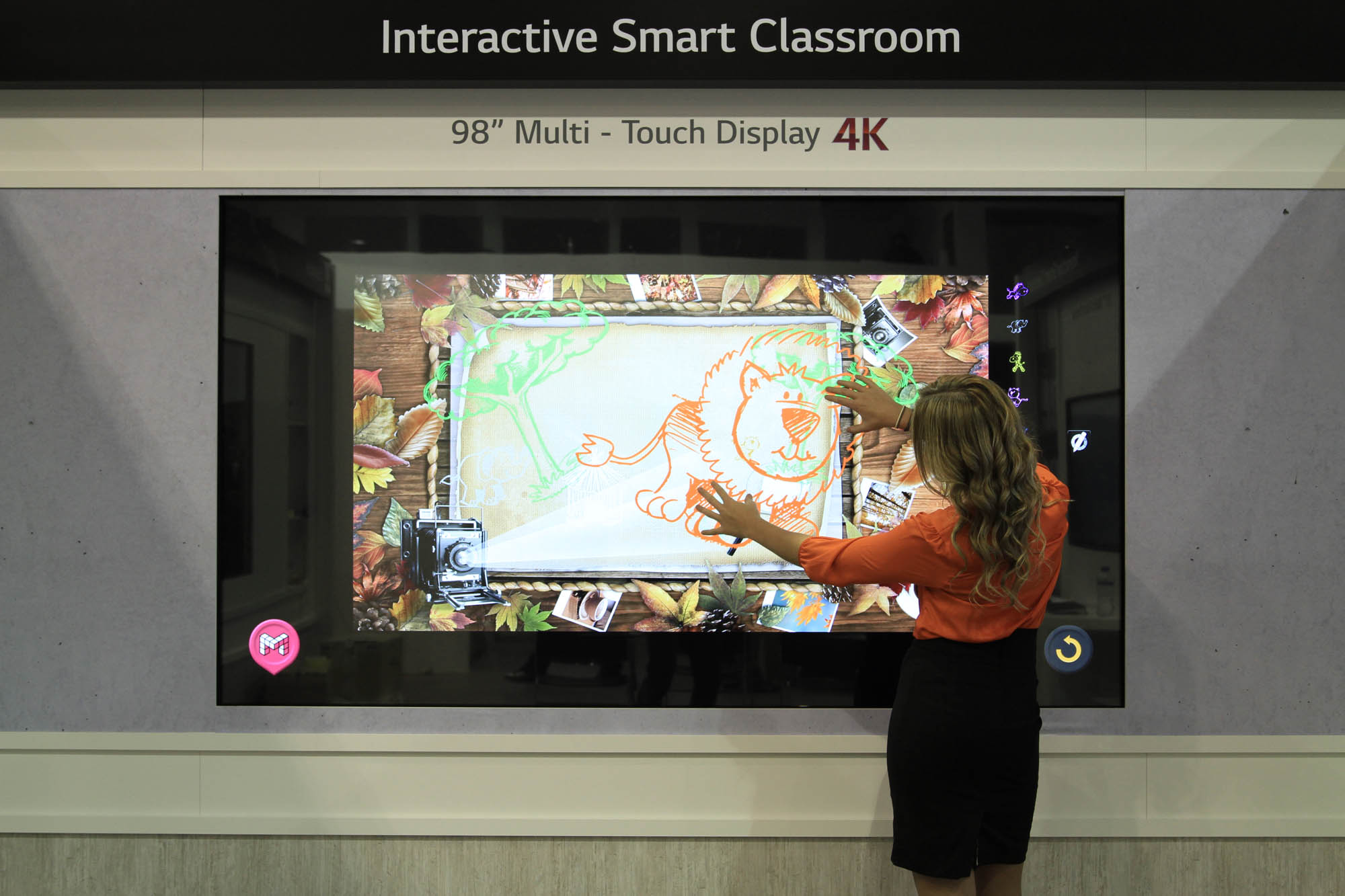A model demonstrating LG's 98-inch ULTRA HD Digital Signage at ISE 2015