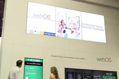 Two models taking a closer look at LG Smart Platform Signage with webOS at ISE 2015