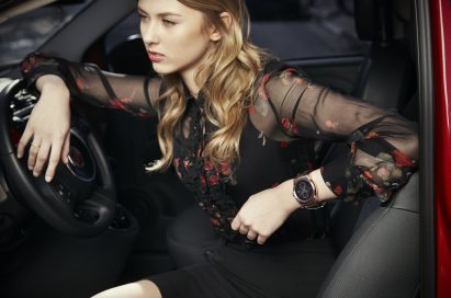 A woman in the driver's seat wearing the LG Watch Urbane as she stares outside the car.