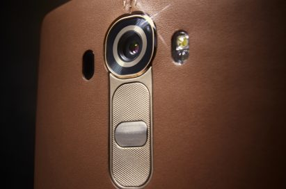 A close-up of the top of the LG G4's back while wearing a brown leather cover.