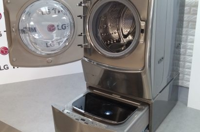LG TWINWash™ washing machine in gray color with front-load on the top and top-load at the bottom. Both washers are opened.