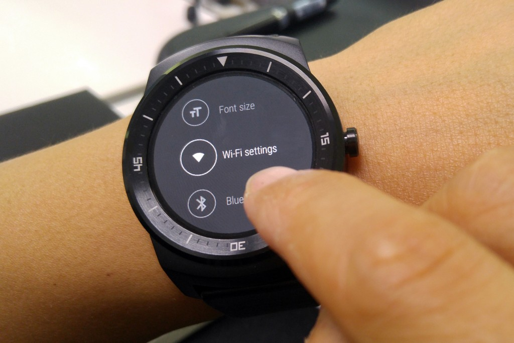 A user of LG G watch is trying to choose the Wi-Fi settings menu on his or her watch.