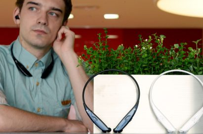 A man is listening to music with LG TONE ULTRA HBS-810 resting his chin on his hand. And a white TONE ULTRA HBS-810 and a black one are displayed in front of him.