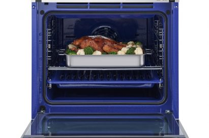 LG Studio oven with door opened and cooked food inside