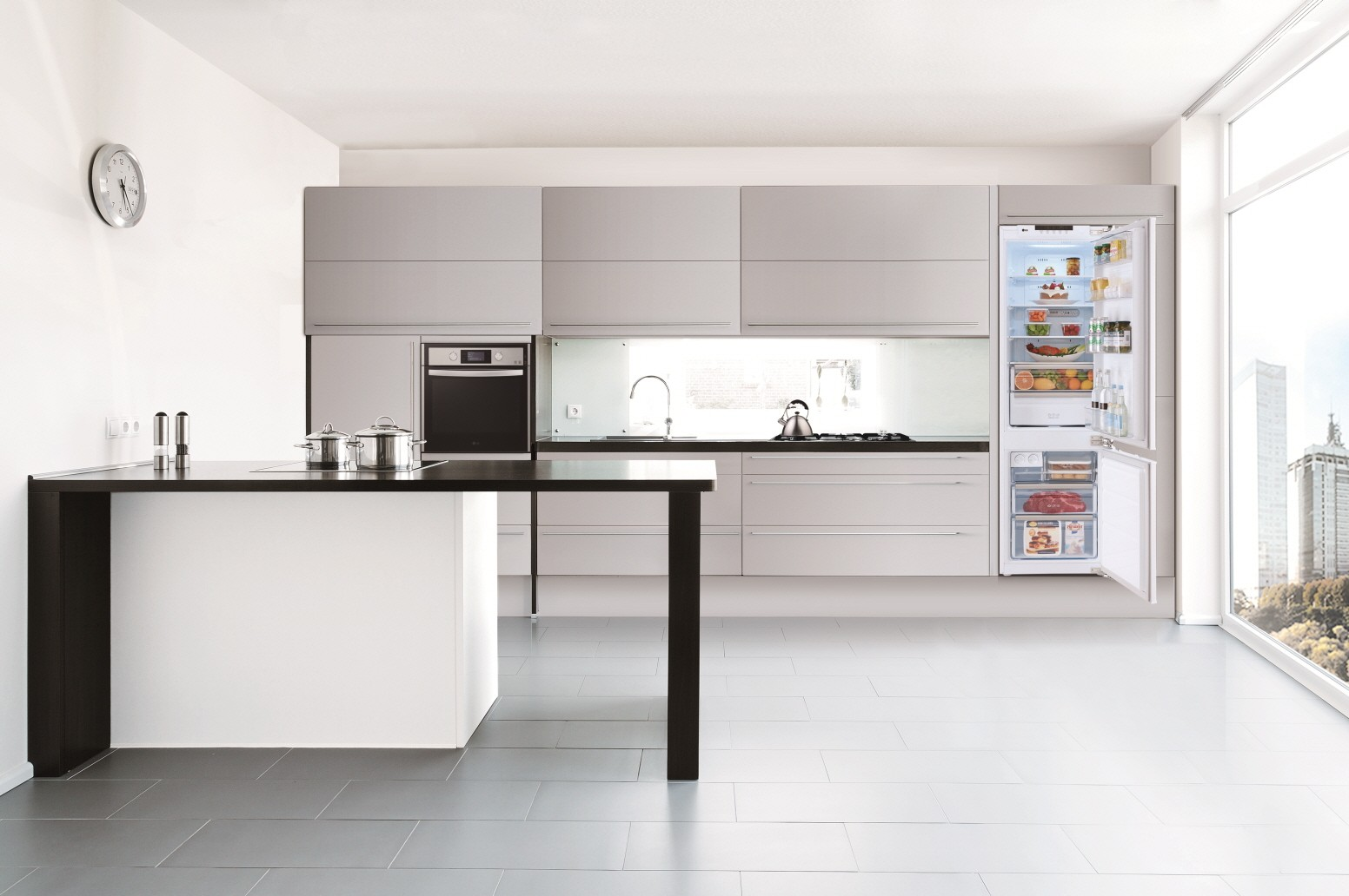 LG Studio line-ups, including oven, refrigerator, dishwasher, induction and gas cooktop, and Speed Oven featured in a kitchen.