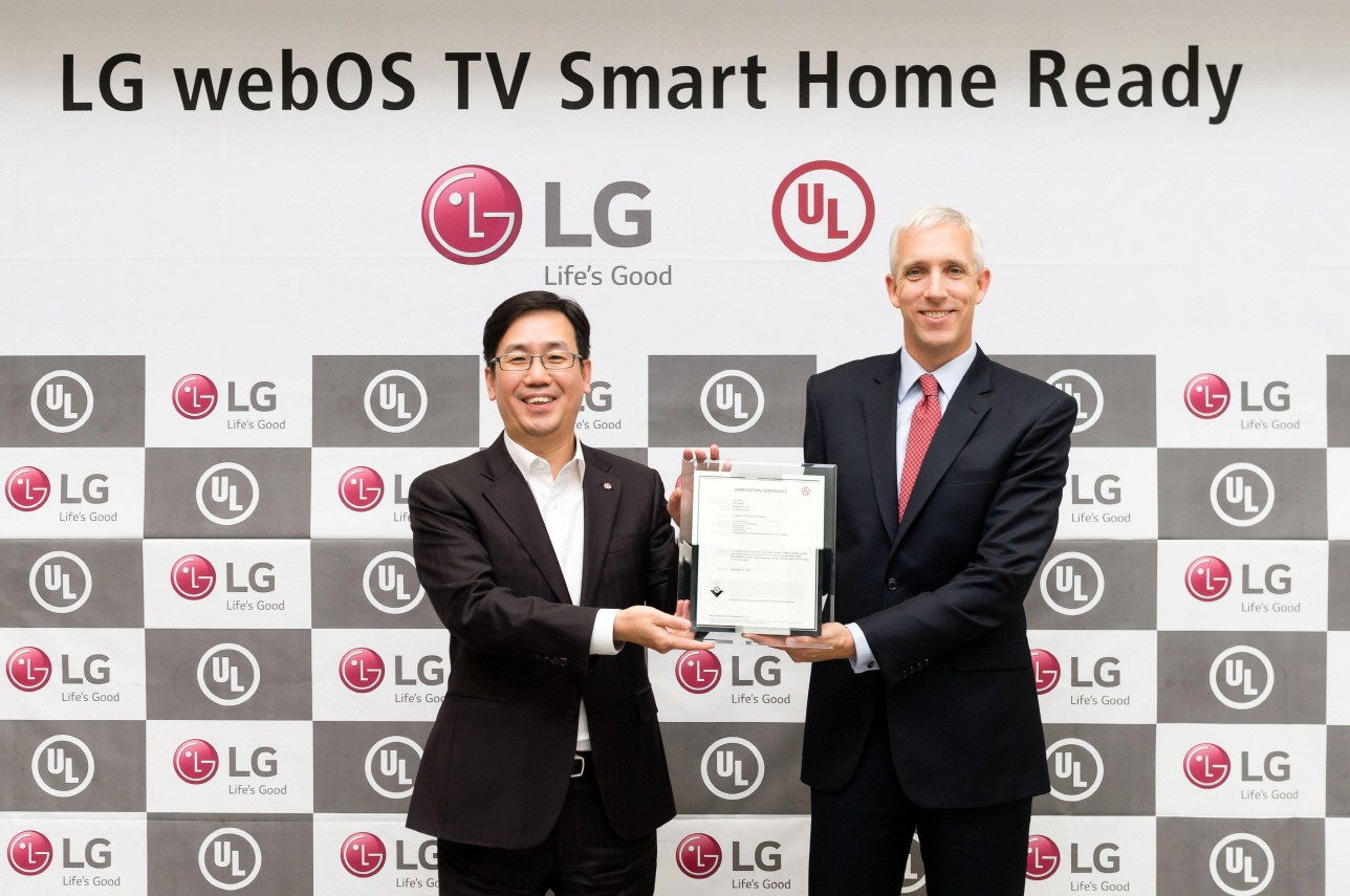 Sam Kim, senior vice president and head of TV product planning at the LG Electronics Home Entertainment, and Jason Fischer, president and managing director of UL's Asia Pacific, hold up the verification certificate from UL
