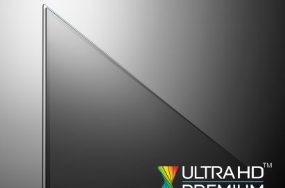 A close-up of the upper left corner of the LG OLED TV with the ULTRA HD PREMIUM logo displayed at the bottom right